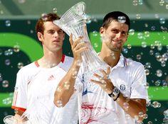 Novak Djokovic celebrates his finals victory over Andy Murray