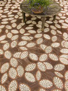 A modern interpretation of traditional Chinese pebble mosaics, the mosaic is sited in a shaded seating area in the kitchen garden at the McEvoy Olive Oil Ranch in northern Marin County, California.