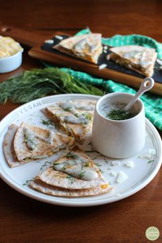 Pierogi quesadillas - All of the flavors you love in a pierogi in quesadilla form. This vegan recipe includes tortillas packed with potatoes, sauteed onions, sauerkraut, and non-dairy cheese with a yogurt ranch sauce. | cadryskitchen.com @cadryskitchen @sodelicious