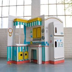 Cardboard kitchen- this looks better than our plastic kitchen!