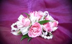 Pink spray roses with pink sheer ribbon on a white pearl bracelet.  #prom by Emil J Nagengast Florist Albany, NY #corsage