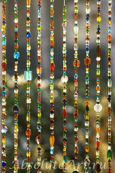 I've been planning to make a curtain like this for years using old costume jewelry, and/or strings of beads that are super cheap at Walmart! Beaded Door Curtains, Bead Curtain Doorway, Bead Crafts, Arts And Crafts, Door Beads, Bohemian Decor, Bohemian Living, Boho Chic, Wind Chimes