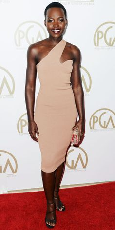 At the 2014 Producers Guild of America Awards, Lupita Nyong'o once again looked impeccable in a nude asymmetric Stella McCartney dress, styling her look with a matching snakeskin clutch, Jamie Wolf earrings and strappy Stella McCartney heels.