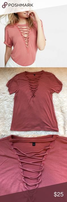"""Sexy front lace up pink tee """"The girlfriend"""" lace up tee from Express- a gorgeous, sexy shirt that's perfect for date night or out with friends! Also features a choker-style at the neck. Size XS and color is a salmon pink. Only worn once- like new! Express Tops Tees - Short Sleeve"""