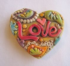 Antiqued Paisley Love Magnet - decorative polymer clay