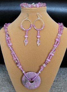 """-SOLD~Strings of Pink~  8mm glass cat's eye, 12x5 twist glass & seed beads.SP twist hook & eye clasp with 50mm donut natural Rhodonite focal. 241/2"""" Bracelet 71/2"""" with SP toggle clasp. Sterling Silver Filled ear wire."""