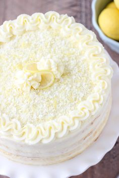 This Limoncello Cake is made with fluffy sponge cake layers, brushed with a limoncello syrup, filled with a thin layer of lemon curd and frosted with a decadent mascarpone and cream cheese frosting. Lemon Desserts, Lemon Recipes, Delicious Desserts, Cake Recipes, Dessert Recipes, Japanese Sweets, Mini Cakes, Cupcake Cakes, Lemon Cupcakes