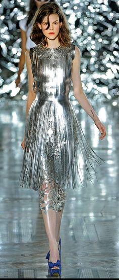 You could make this an alien costume... silver shirt  with long tinsel skirt from party city or a silver dress...than make it up into an alien!