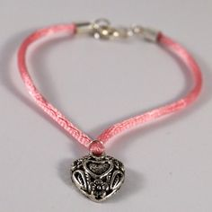 Pink bracelet with heart charm by TosTosia