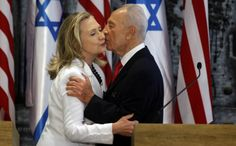 Israeli President Shimon Peres and U.S. Secretary of State Hillary Clinton embrace after a joint press conference on July 16 in Jerusalem