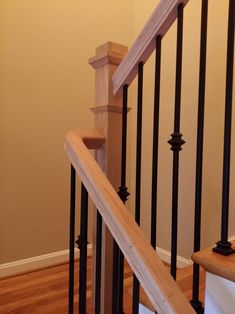 stair railing with boxed newel posts and wrought iron balusters