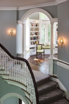 Stairs, arched cased opening with columns (I'd make them square instead of round if it was me), color