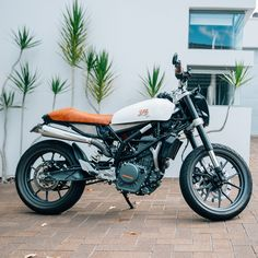 Nina wanted something unique, a modern bike that was reliable with fuel injection and ABS but with an old school cafe racer look....