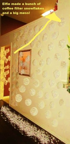 Elfie covered the wall & doorway with coffee filter snowflakes & covered the floor with the paper cuttings.