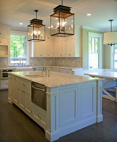 Just about PERFECT! Lanterns, cabinets, counters, floor, hardware, love it all