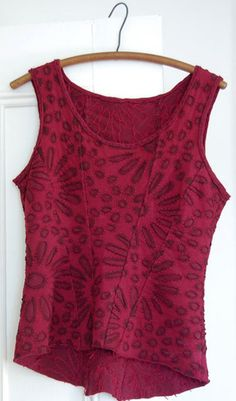 Alabama Chanin corset, recycle two tee shirt cut out work is done first, layer other tee shirt under cut work.