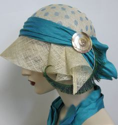 Beautiful color, feather and polka dots, what's not to like?    --- 1920's Style Cloche. $128.00, via Etsy.