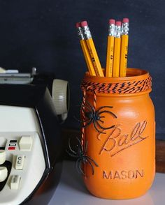 Jazz up your office desk on Halloween with this mason jar DIY.