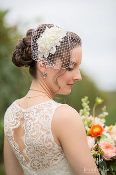 Updo & natural makeup with a birdcage headpiece.  #updo #makeup #weddingmakeup #birdcage #wedding #bride #weddinghair #upstylebeauty  www.upstylebeauty.com