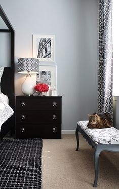 Chic gray & black bedroom design with gray blue walls paint color, black canopy bed, black graphic rug, black chandelier, white lamp with DwellStudio Gate charcoal fabric lamp shade and DwellStudio Soft Scrolls fabric duvet & shams.