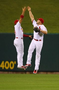 Jon Jay and Matt Holliday celebrate after a win over the Cubs Monday.