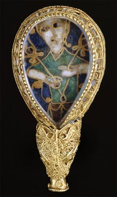"""The Alfred Jewel is a Anglo-Saxon ornament made of enamel and quartz enclosed in gold that was discovered in 1693. It has been dated from the late 9th century. It was made in the reign of Alfred the Great and is inscribed """"aelfred mec heht gewyrcan"""", meaning 'Alfred ordered me made'.Ca.  900 A.D. Medieval."""