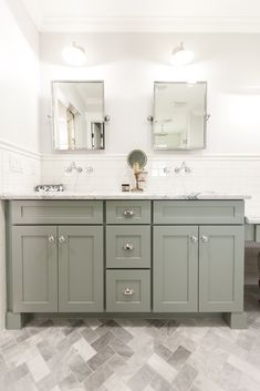 Grey shaker style bath vanity with carrara marble counter top - as featured on 'Rafterhouse' pilot episode on HGTV.