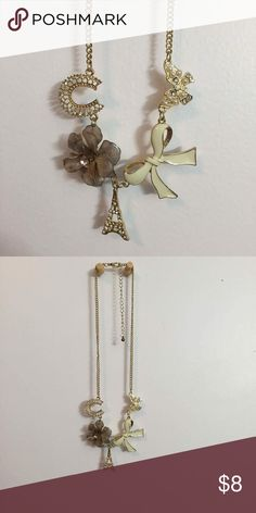 Gold Charm Necklace Gold necklace with cute charms!(: never worn!    My bundles are buy 2, get 25% off!!! Jewelry Necklaces