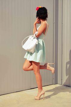 High heel salute in a short dress