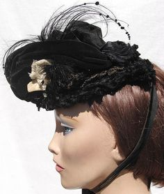 "Age: 1860s (Victorian Era) Color: Black and Cream Materials: Velvet, Silk, Chenille, Feathers, Jet Beading, Sequins, Rhinestone Brooch Sizing: Measures about 9"" in length by about 7"" in width Antique"