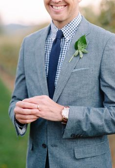Grey suit, simple succulent boutonniere, blue checkered shirt // Sera Petras Photography
