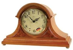 "Hermle Amelia Oak Tambour Mantel Clock - Beautiful styled tambour clock in an classic oak or cherry finish. With brass feet, raised burl veneer panels and a beaded molding across the bottom. Quartz movement plays ½ hour Bim-Bam or 4/4 Westminster chime with volume control and night shut-off.  Measures: H 11 3/8"" x W 18 1/8"" x D 6 1/2""   Three year manufacturer's warranty    Free shipping"