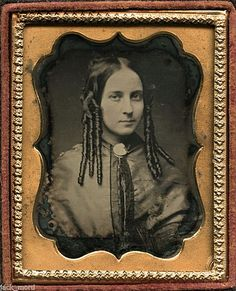 Check out that hair!  Likely from late 1840's.
