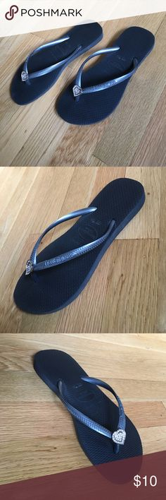 Havaianas black/slate thongs size 7 or 7.5 Havaianas black/slate thongs size 7 or 7.5. Black and slate with metallic heart and crystal accents. Made in Brazil. Please note the size markings. Brazilian size 35–36. On the sandal it says USA size 4/5. I do not believe this is correct. It says European size 37/38. I will use the European size on the size conversion chart. Used. Light signs of wear on the soles. See pictures. All sales final. Havaianas Shoes
