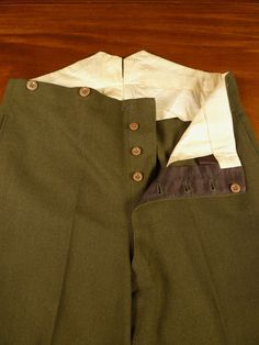 English-cut trouser detail; fishtail back, buttons for braces, button fly, high rise.