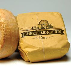 The Cheese Monger's Cave needs a new logo