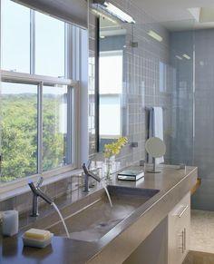 Gorgeous beach house bathroom: love the tile; glass shower enclosure; concrete (silestone?) sink w/double faucets