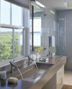 big bathroom sink - double size cast concrete master bathroom sink with double faucets - Hutker Architects via Atticmag