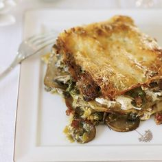"Celery Root and Mushroom Lasagna | ""In Marche, we only make lasagna for special occasions like Christmas,"" Fabio Trabocchi says. For this streamlined version of his luxe lasagna in bianco (white lasagna), he layers flat noodles with a supremely rich sauce, along with a root-vegetable ragù, fresh mozzarella and whole basil leaves."