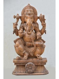 """Lord Ganesh Holding Broken Tusk And Mango Wooden Murti Ganesh holds a noose, elephant urge, mango and his messed up tusk he used to compose the Mahabharata epic and is encompassed by a curve with the substance of Mahakala or """"Extraordinary T Hindu Statues, The Mahabharata, Ganesh Statue, Wood Wall Decor, Indian Gods, Hold On, Mango, Lion Sculpture, Art Deco"""