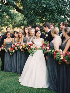 dark gray bridesmaid dresses with pink and berry flowers
