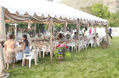 Time of Our Lives: wedding reception tent draped with burlap and twinkly lights