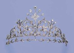AN ANTIQUE DIAMOND NECKLACE/TIARA  The front section designed as an openwork diamond scrolling panel with diamond collet centre suspending a detachable five-stone palmette to the similar but smaller spacers, scrolling sides and collet detailed backchain, mounted in silver and gold, with fitting for a tiara, circa 1880, 37.4 cm. long, in original brown leather fitted case stamped R.G. Dodd & Sons, 42 Cornhill, London