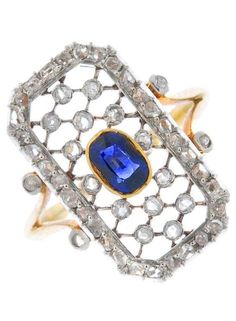 An early 20th century gold sapphire and diamond dress ring. The oval-shape sapphire collet, within a rectangular-shape rose-cut diamond lattice surround, to the similarly-cut diamond bifurcated shoulders and plain band. #vintage #ring