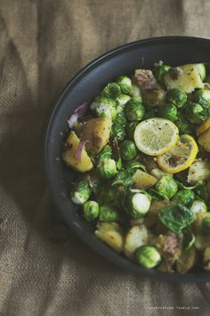 Rosemary, Lemon & Garlic Potatoes and Brussels by hipsterfood #Potatoes #Brussel_Sprouts