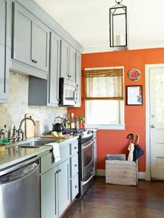 End wall of narrow gallery kitchen painted bright color