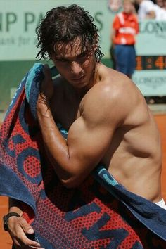 Spain's Rafael Nadal wipes his body after defeating compatriot David Ferrer during their semifinal match in the French Open tennis tournament at the Roland Garros stadium in Paris, Friday, June Tennis Rafael Nadal, Nadal Tennis, Le Tennis, Tennis World, Tennis Tournaments, Tennis Players, Nadal Roland Garros, Wimbledon 2012, Rafa Nadal