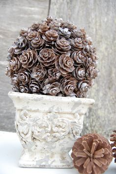 PInecone topiary... I am so going to make this. I even saw the base at Hobby Lobby!