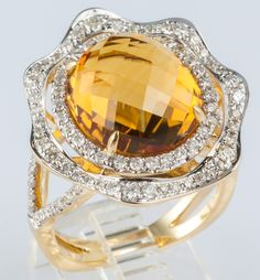 7.27ct Faceted oval citrine, 13.5 x 12.0 mm, set in a halo of brilliant SI diamonds, .90ct total. Undulating shape of diamond halo contrasts distinctively with geometric facets of pastel citrine. Produced by designer Michael Christoff. Size: 6.75  $999.00