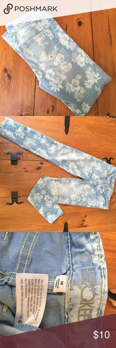 Cherokee denim jeggings light wash, floral size 10 Cherokee light wash floral jeggings.  Adjustable waist.  Some spots are more faded, not from wear, but from original wash of the fabric. Cherokee Bottoms Jeans